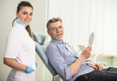 dentist with patient hero image