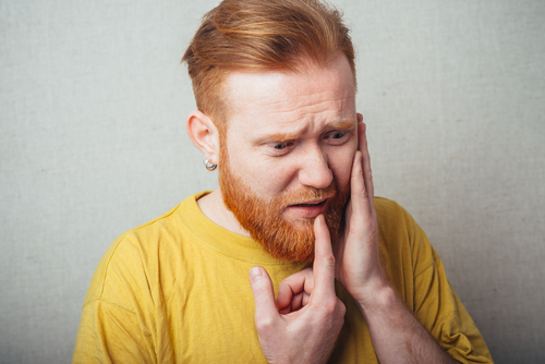 man in dental pain
